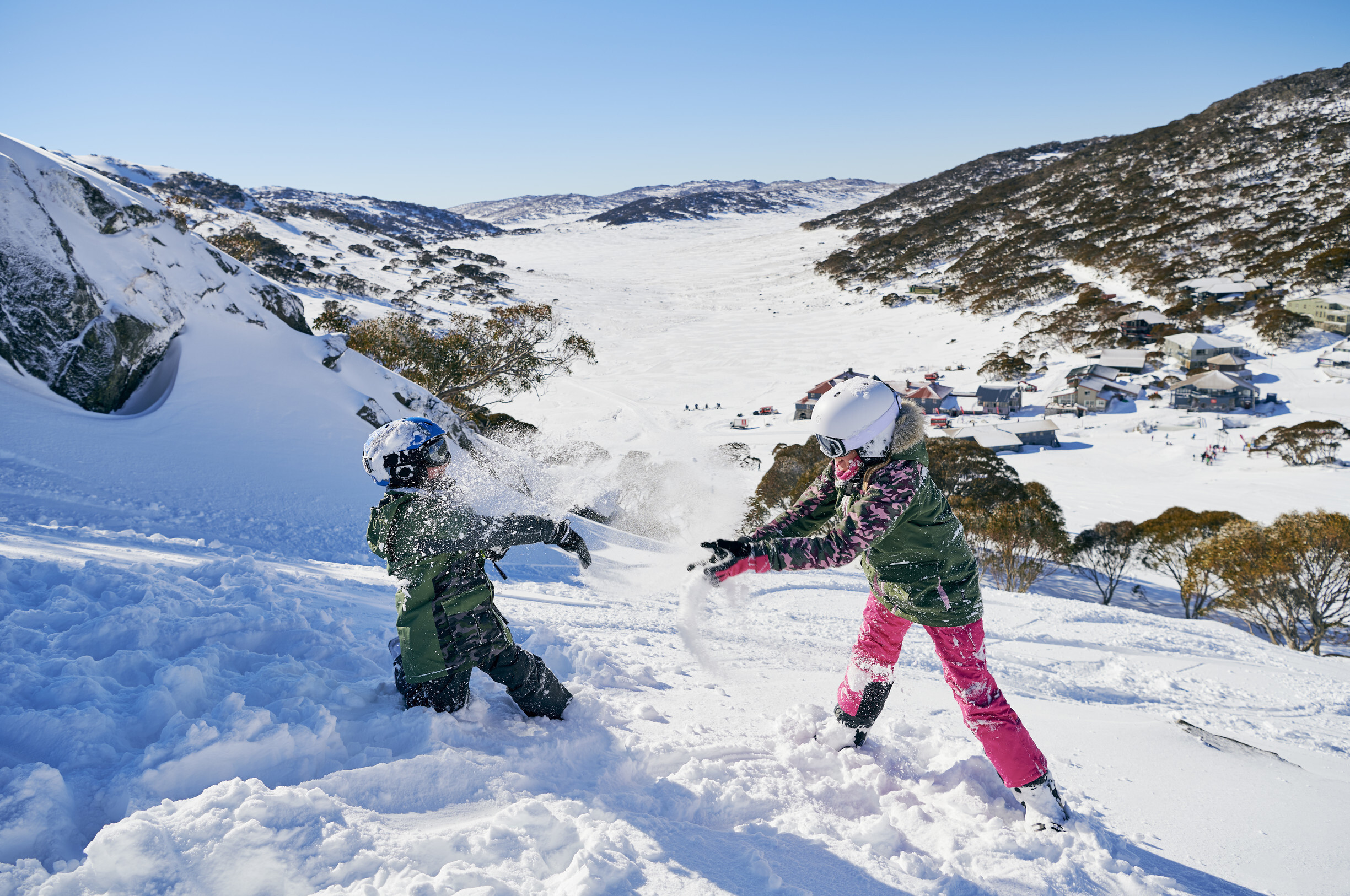 Children enjoying a fun day in the snow at Charlottes Pass in the Snowy Mountains.