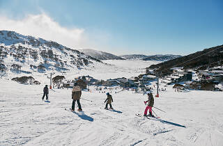 Family enjoying a day of skiing at Charlotte Pass Ski Resort in the Snowy Mountains.