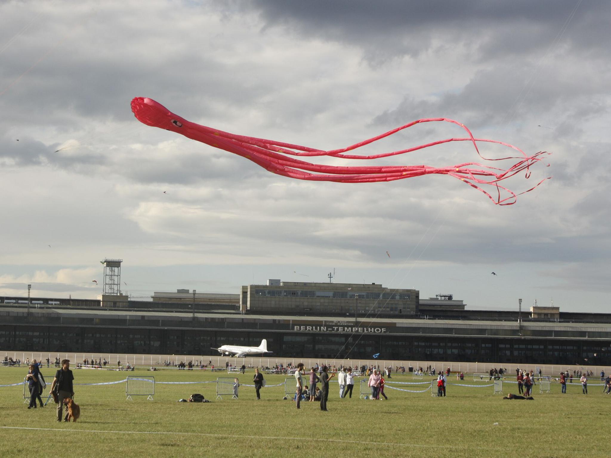 A kite flies over Tempelhofer Feld in Berlin