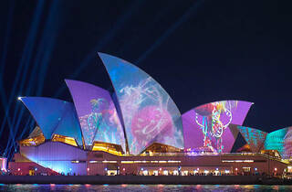 The Sydney Opera House sails with a light projection.
