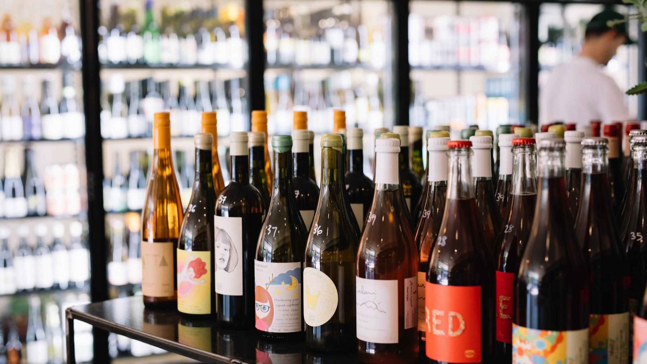 Wine bottles on shelf at Winona