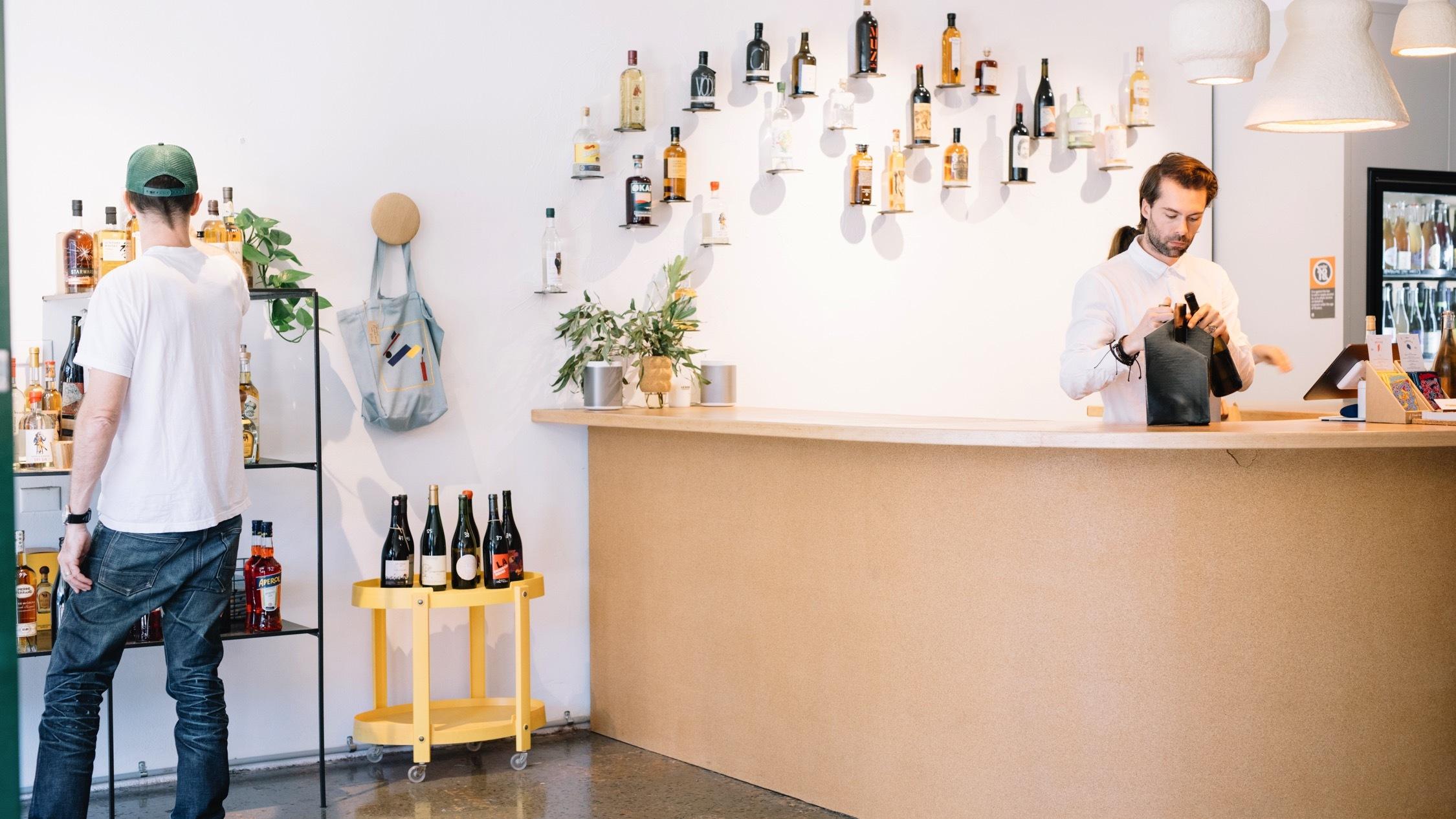 Person inside wine store at Winona