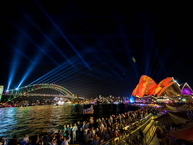 Vivid Light 2019 installations shinning by the harbour with walking crowds.