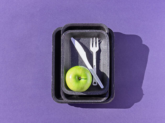 Plastic styrofoam disposable plates and cutlery - stock image