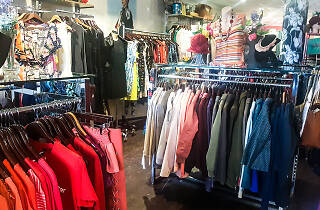 Colourful racks of clothes at the Red Cross Op Shop in Newtown.