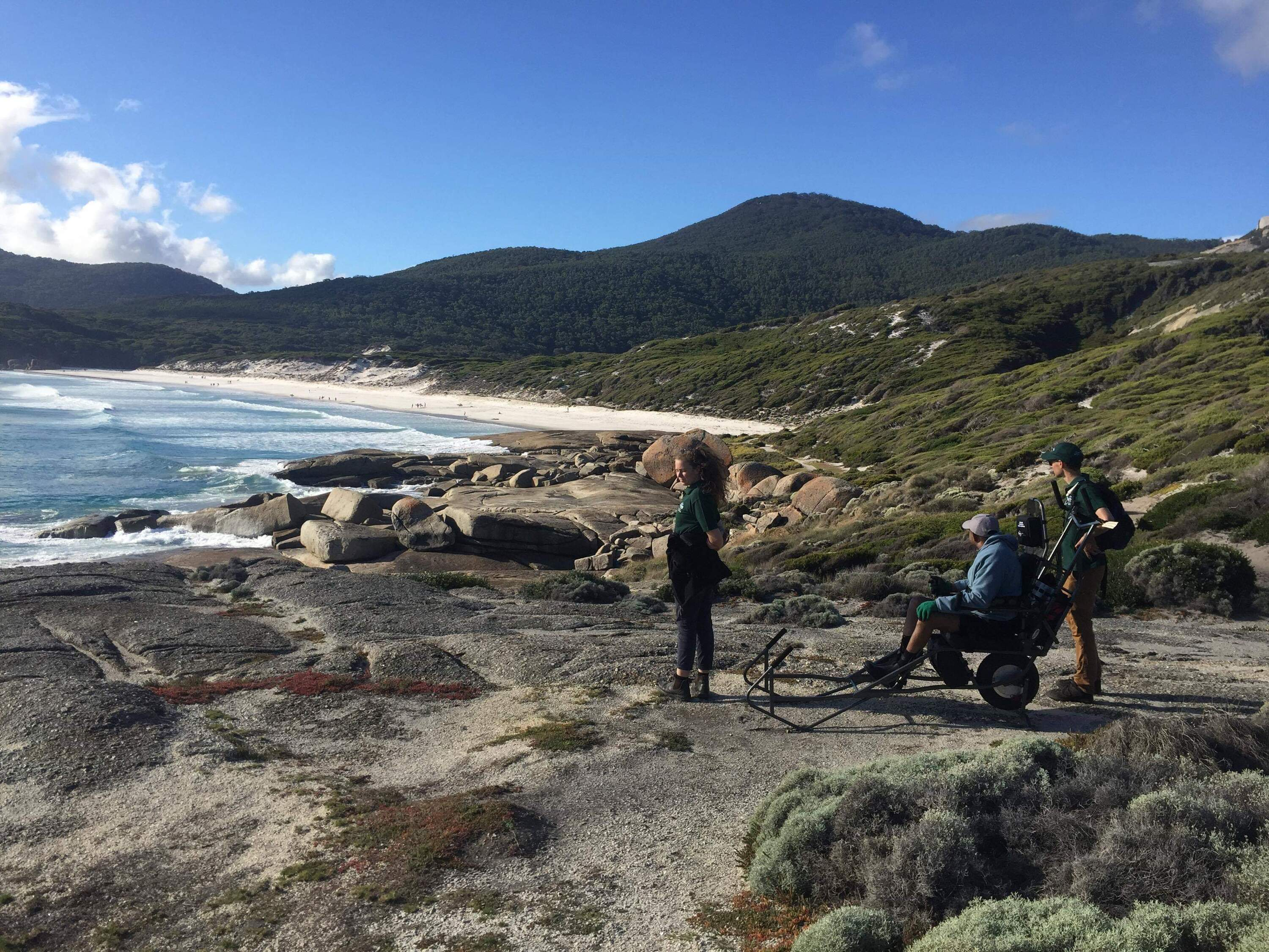 Wheelchair user near beach at Wilsons Promontory