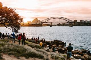 Group of people watching the sunset over Sydney harbour in the winter