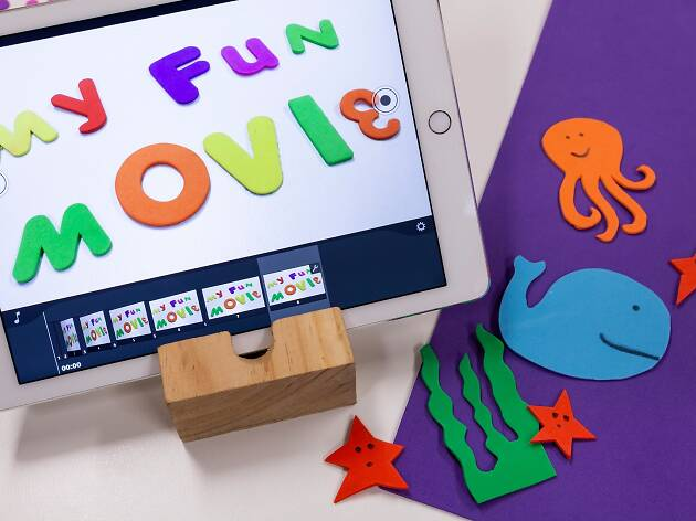 """A child's sleeve with animated animals on it in front of a white piece of paper that spells out """"My fun movie""""."""