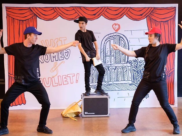 Actors playing Romeo and Juliet on stage.
