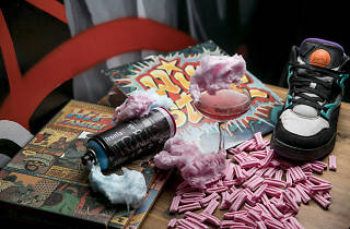 Hip hop records, fairy floss, cocktail and a sneaker on a table at Redfern bar Hustle and Flow