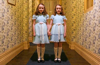 Two children holding hands in blue dress, Still from The Shining (1980)