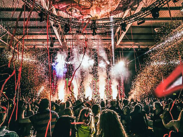 People dancing as confetti falls in a club.