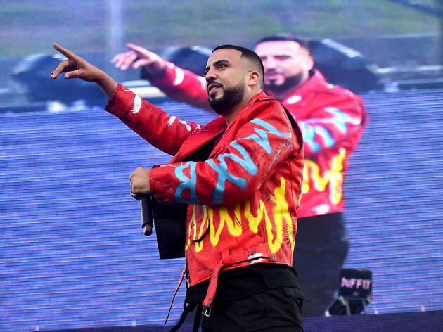 Rapper French Montana performing onstage in front of a video screen.