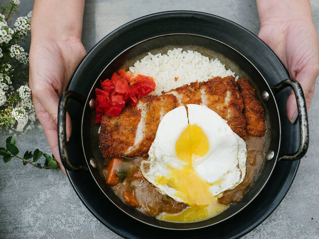 <p>Pork tonkatsu with curry rice and fried egg</p>