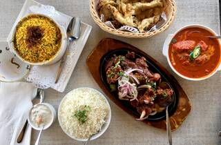 Curries, rice and naan on a table