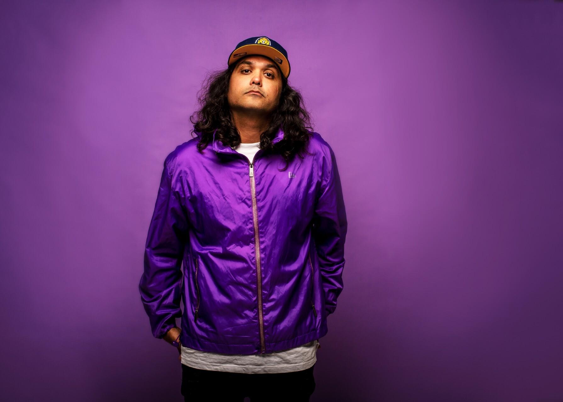 Northern Territory rapper Birdz press shot against purple background