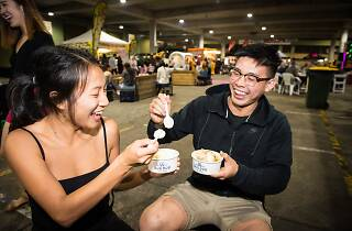People eating at Paddy's Night Food Markets.