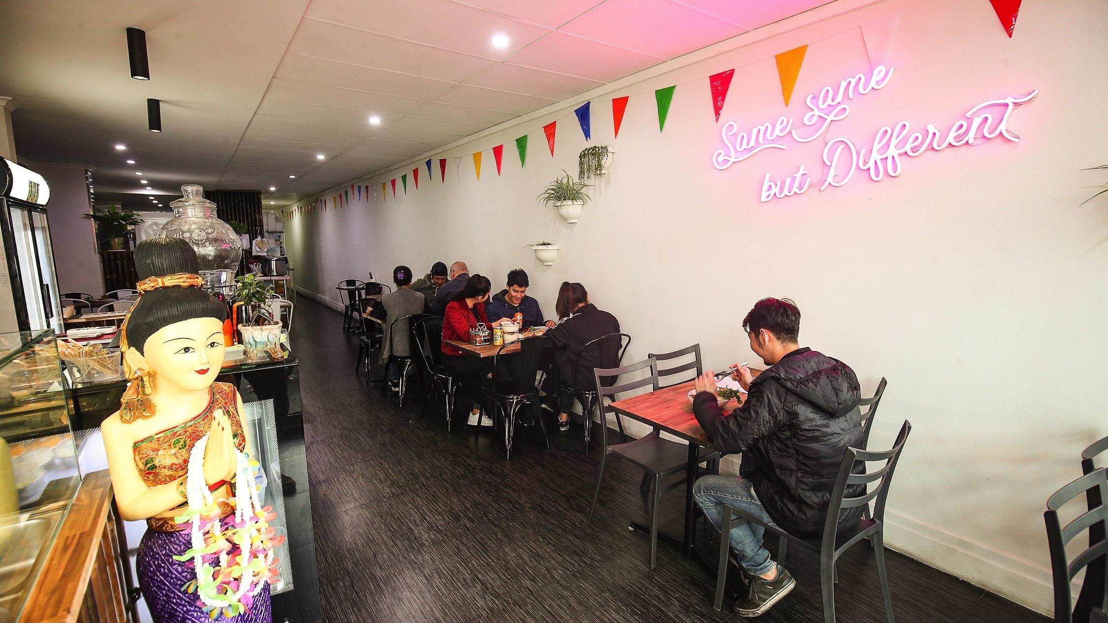 People eating inside restaurant at Isaan Thai Street Food
