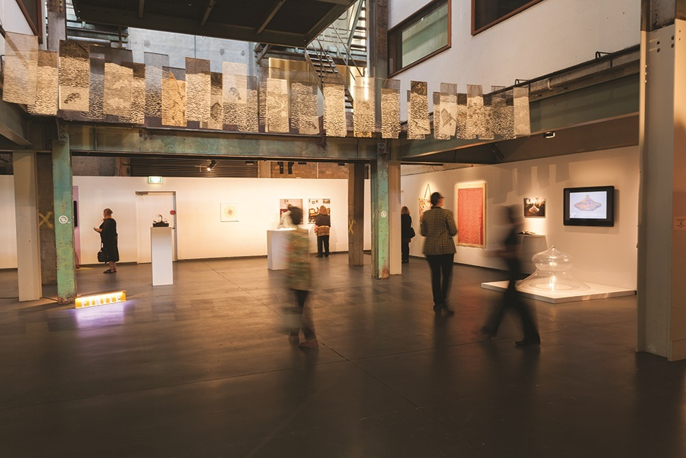 People walking through the Casula Powerhouse galleries.