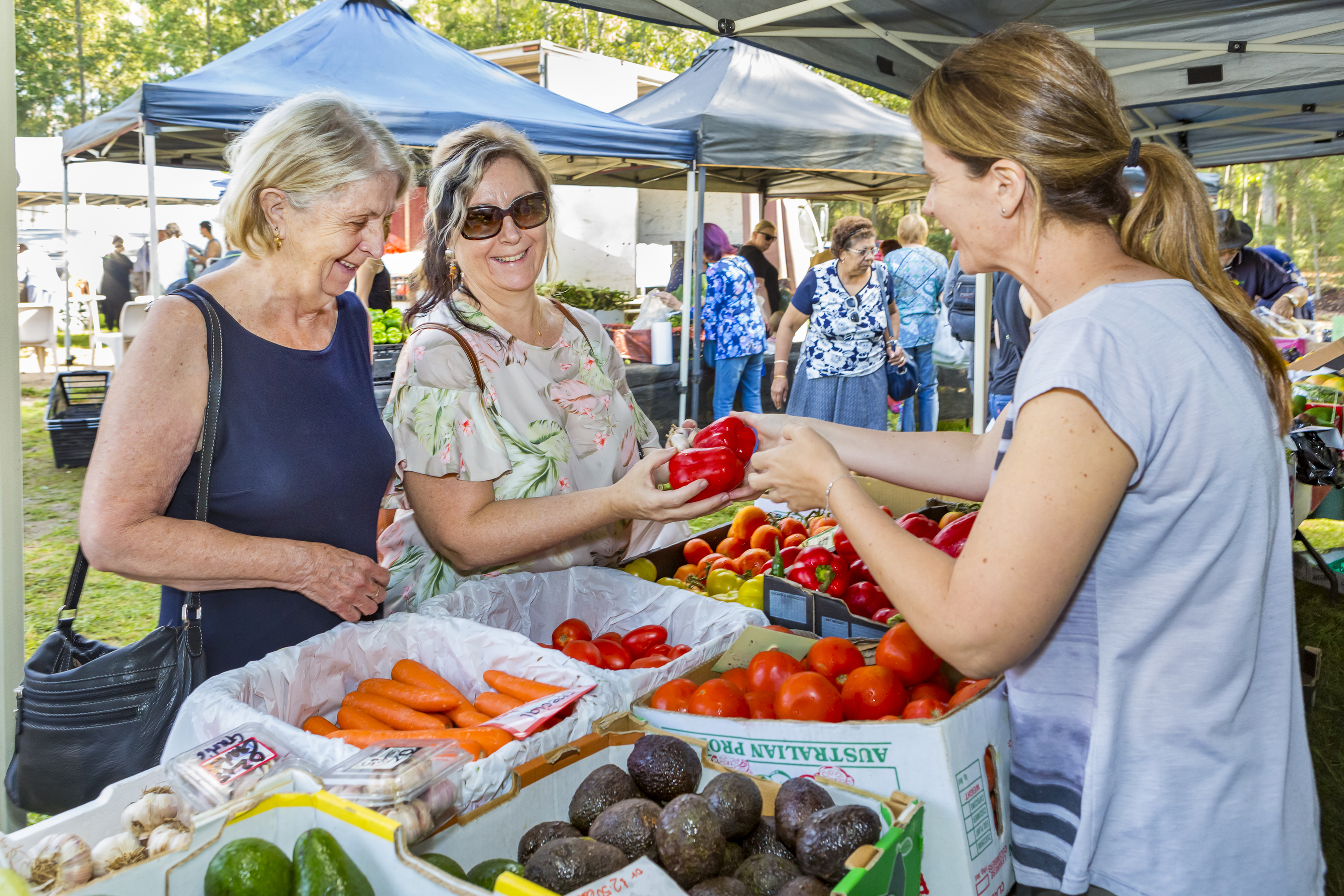People shopping for produce at the Liverpool Growers & Foodies Market.