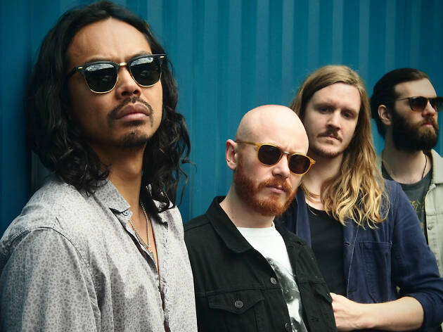 Press shot of the Temper Trap against a blue background