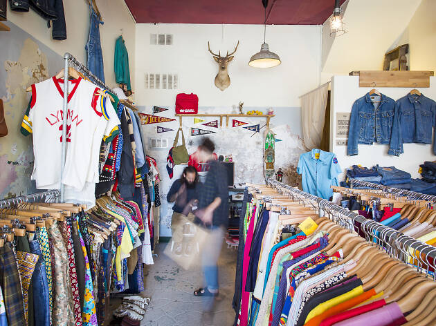 People shopping at the Collective Ensemble vintage store.