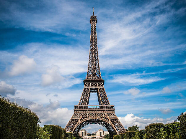 A view of the Eiffel Tower with blue skies