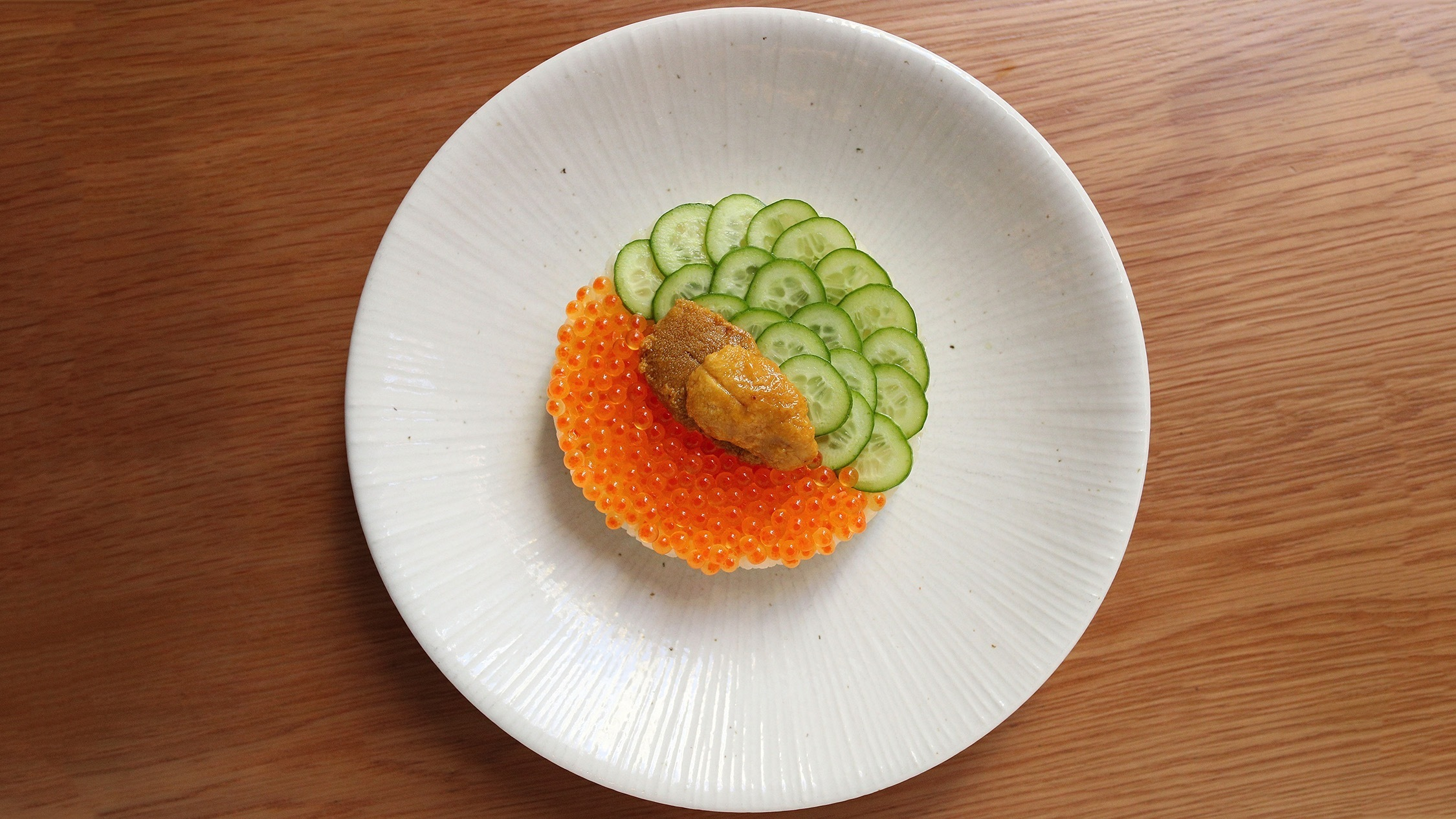 Dish of caviar and cucumber presented in a circle