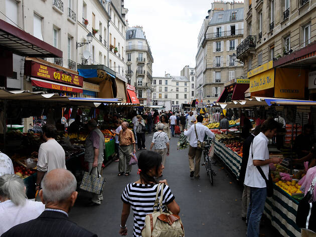 A bustling street scene at the Marché d'Aligre in Paris