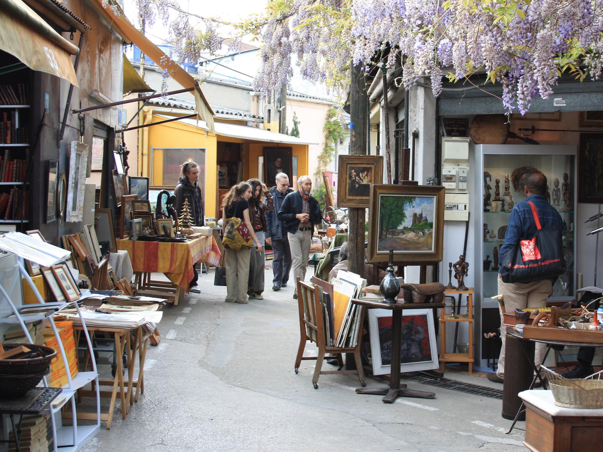 Vendors and shoppers at the Puces de St Ouen flea market