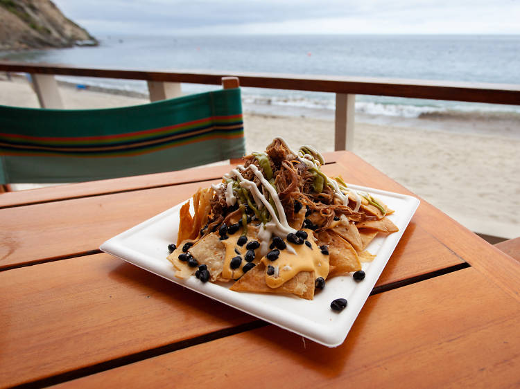 Have a drink on the sand at Descanso Beach Club
