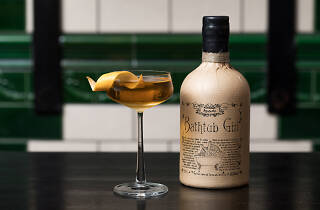 A cocktail next to a bottle of Ableforth's Bathtub Gin.