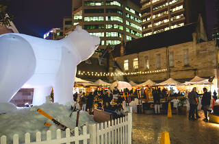Greenwood Hotel courtyard with a giant inflatable polar bear and snow.