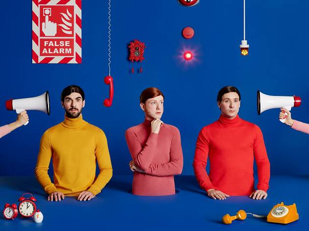 Press image for Two Door Cinema Club with blue backdrop