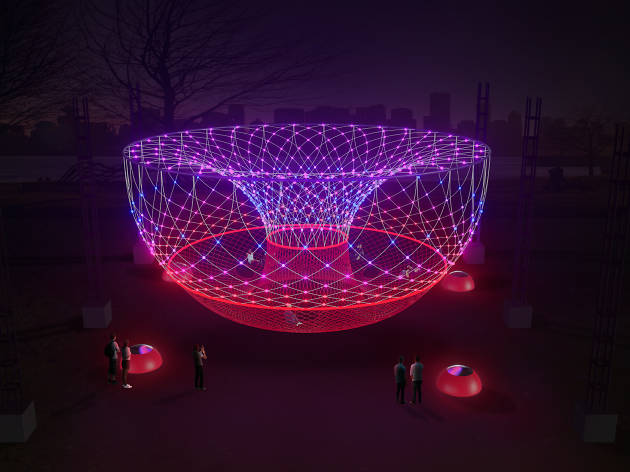 Glowing installation of woven rope with people sitting inside and outside of it