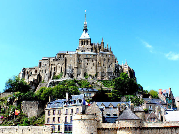 Mont Saint-Michel in Normandy against a blue sky