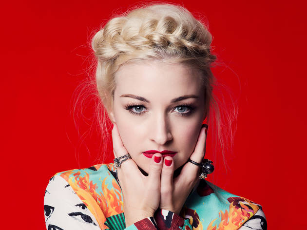 Kate Miller-Heidke infront of red background