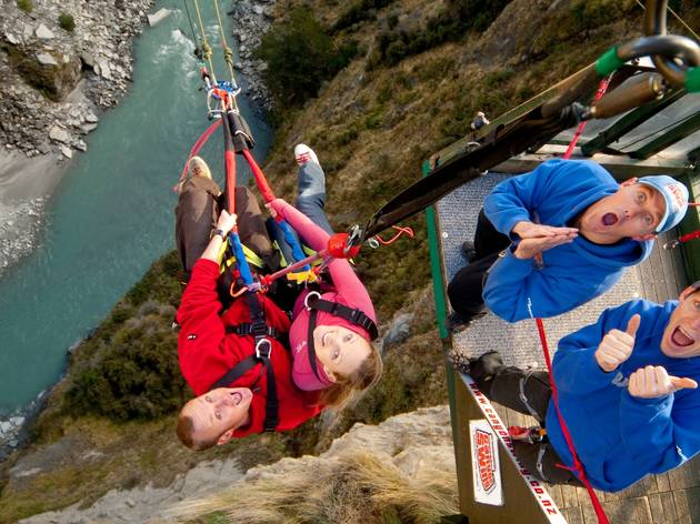 A couple dangles over the river at Shotover Canyon Fox Queenstown