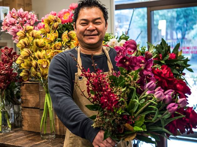 person holding flower inside at Rococo Florists Flower Store
