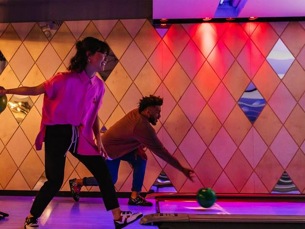 People bowling Inside bowling alley at Strike Bowling