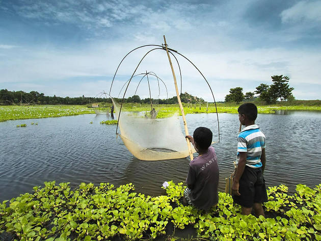 Two children fishing in Assam