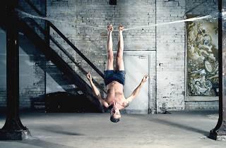 High Performance Packing Tape man upside down on packing tape bridge