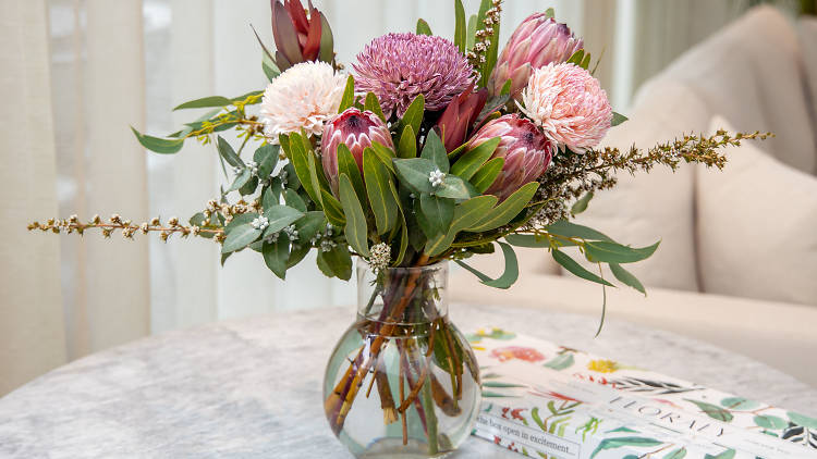 Native flowers in a vase with a Floraly letterbox gift box