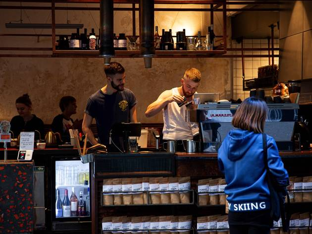 Person making coffee behind counter at Single O cafe