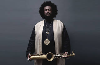Kamasi Washington press shot holding saxophone