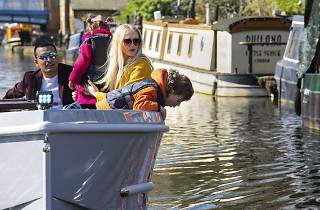 Family on a boat in London - for London's best watersports for kids feature