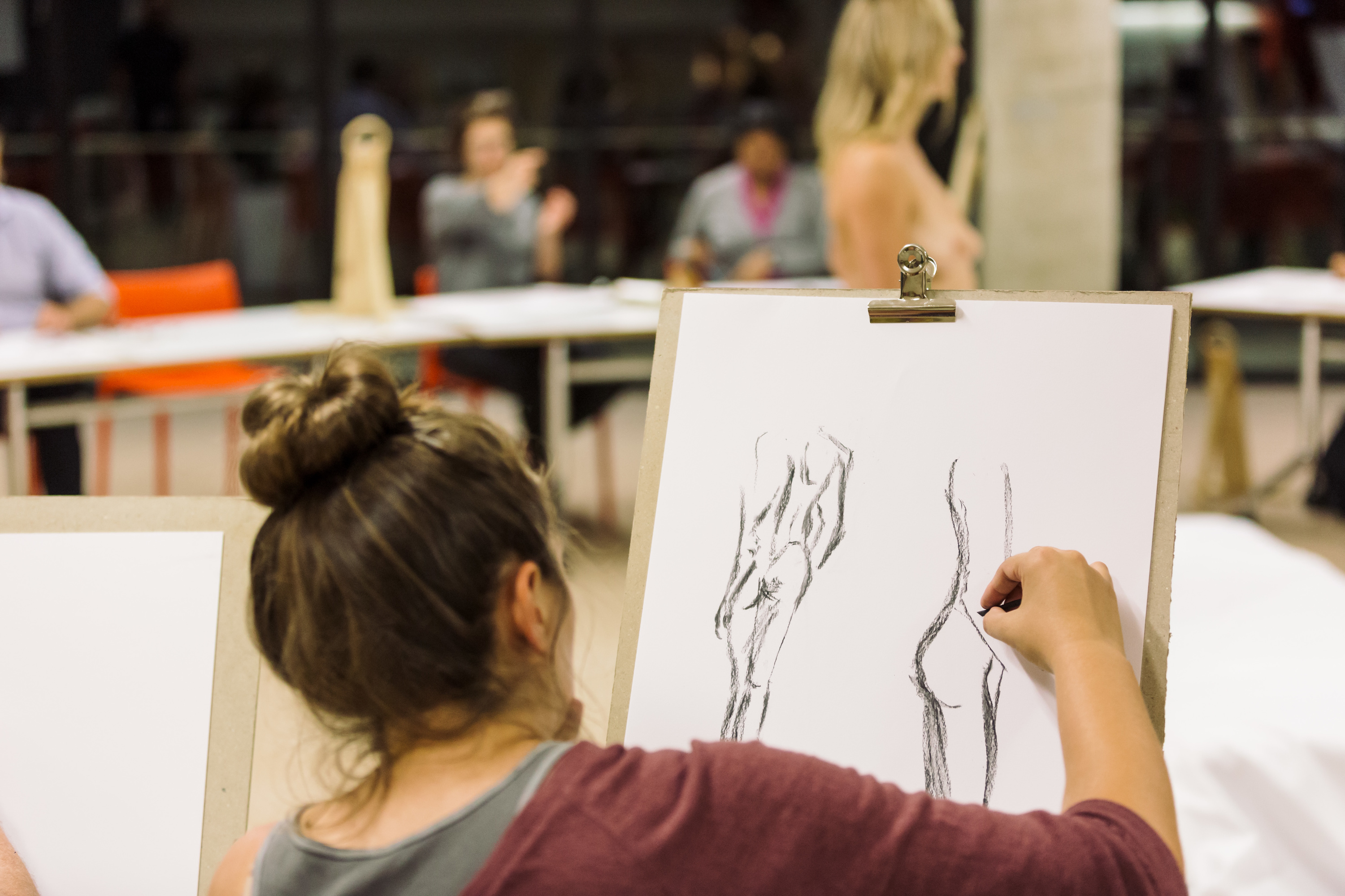 People drawing bodies at the Sundown Sketch Club.