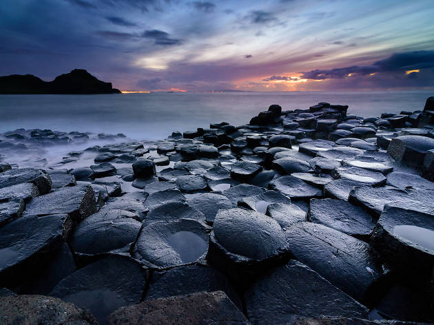 Sun sets over Giant's Causeway in Northern Ireland