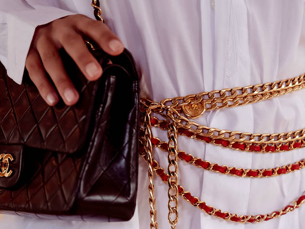 Close up of hand on Chanel purse