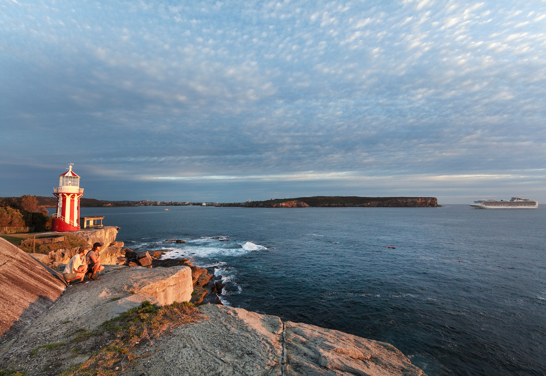 The red and white stripped Hornby Lighthouse looking at South Head at sunset.